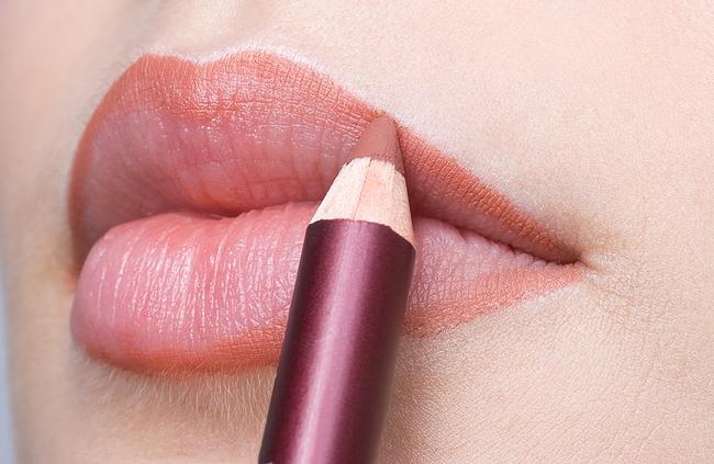make up, applying lips liner pencil on beautiful lips